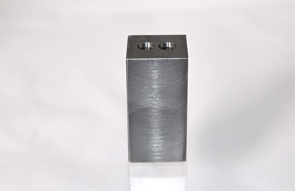 Machined block per customer specifications