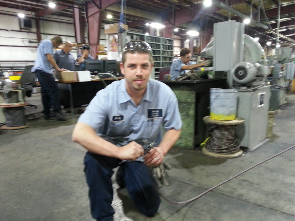 Smitty (assembly lead) checking swaged diameter