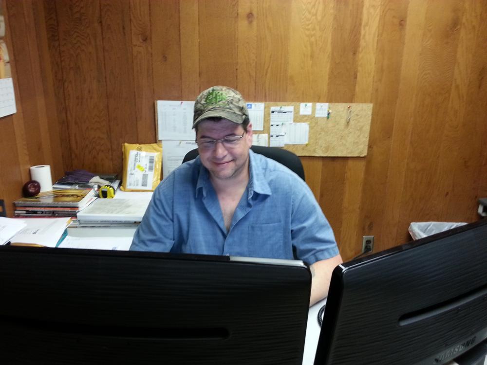 Tim working on customer orders
