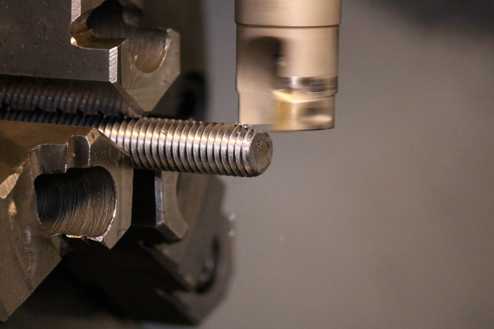 Milling wrench flats on a threaded stud